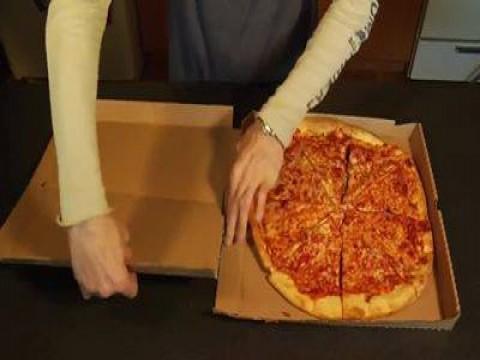 بالفيديو اكل البيتزا كالمحترفين